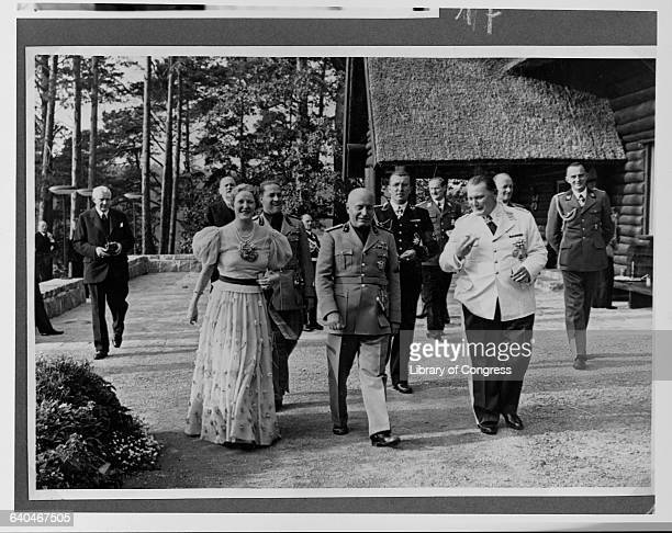 Benito Mussolini walks with Emmy and Hermann Goering at Carinhall Goering's estate north of Berlin | Location Carinhall Schorfheide Germany