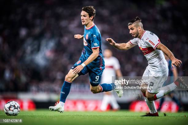 Benito Raman of Duesseldorf and Emiliano Insua Zapata of Stuttgart in action during the Bundesliga match between VfB Stuttgart and Fortuna...