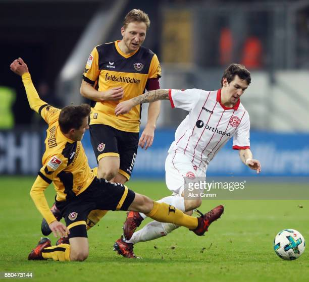 Benito Raman of Duesseldorf eludes Niklas Hauptmann and Marco Hartmann of Dresden during the Second Bundesliga match between Fortuna Duesseldorf and...