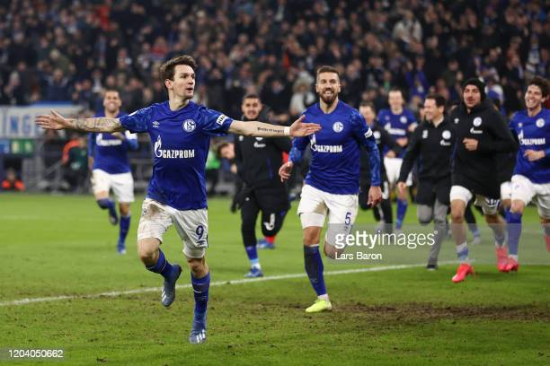 Benito Raman of FC Schalke celebrates after scoring his team's third goal during the DFB Cup round of sixteen match between FC Schalke 04 and Hertha...