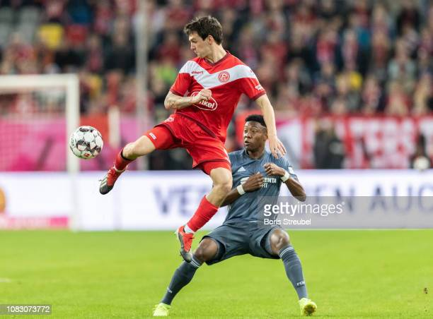 Benito Raman of Fortuna Duesseldorf battles for the ball with David Alaba of FC Bayern Muenchen during the Telekom Cup 2019 semifinal match between...