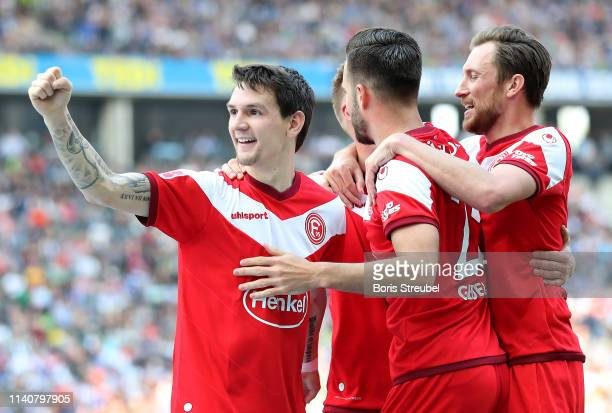 Benito Raman of Fortuna Duesseldorf celebrates after scoring his team's first goal with his team mates during the Bundesliga match between Hertha BSC...