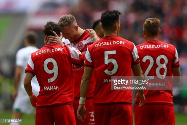 Benito Raman of Fortuna Duesseldorf celebrates after scoring his team's first goal with team mates during the Bundesliga match between Fortuna...