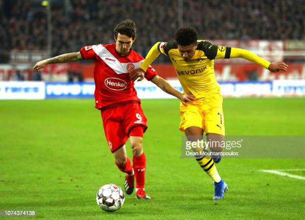Benito Raman of Fortuna Duesseldorf is challenged by Jadon Sancho of Borussia Dortmund during the Bundesliga match between Fortuna Duesseldorf and...