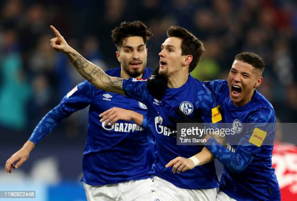 Benito Raman of Schalke celebrates with team mates after scoring his teams first goal during the Bundesliga match between FC Schalke 04 and 1 FC...