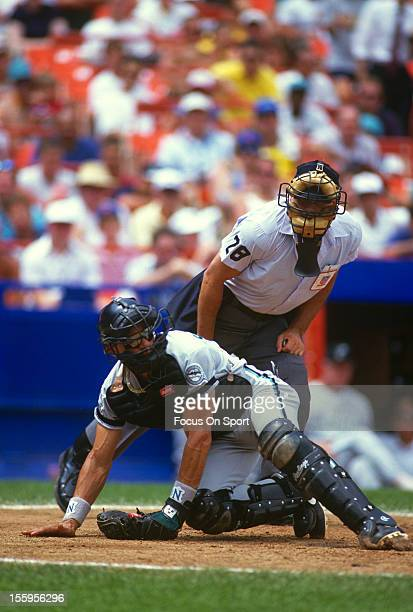 Benito Santiago of the Florida Marlins looks on at the play against the New York Mets during an Major League Baseball game circa 1993 at Shea Stadium...