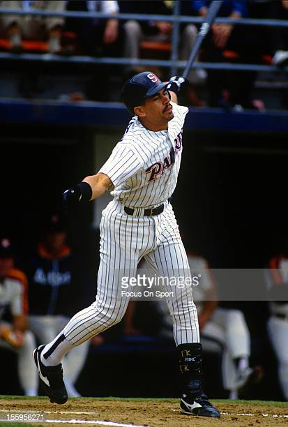 Benito Santiago of the San Diego Padres bats against the Houston Astros during an Major League Baseball game circa 1990 at Jack Murphy Stadium in San...