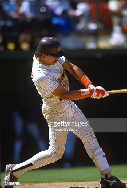 Benito Santiago of the San Diego Padres bats during an Major League Baseball game circa 1989 at Jack Murphy Stadium in San Diego California Santiago...