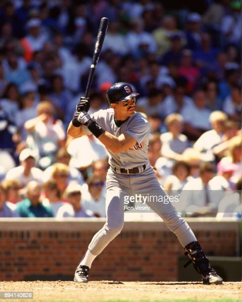Benito Santiago of the San Diego Padres bats during an MLB game at Wrigley Field in Chicago Illinois during the 1990 season