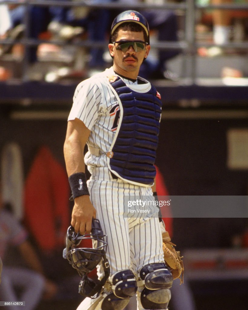Benito Santiago of the San Diego Padres catches during an MLB game at Jack Murphy Stadium in San Diego, California during the 1992 season.