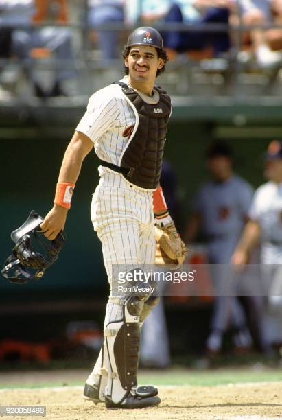 Benito Santiago of the San Diego Padres catches during an MLB game at Jack Murphy Stadium in San Diego California during the 1988 season