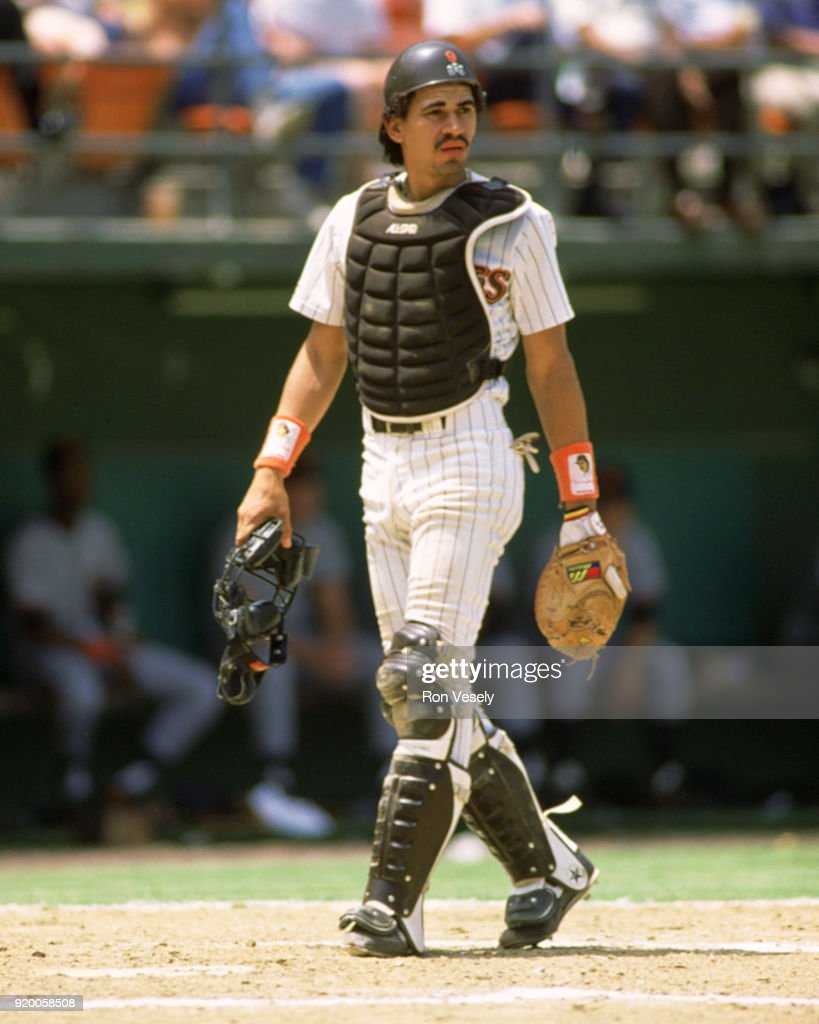 Benito Santiago of the San Diego Padres catches during an MLB game at Jack Murphy Stadium in San Diego, California during the 1988 season.