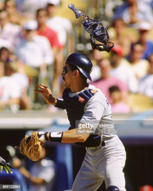 Benito Santiago of the San Diego Padres catches in an MLB game at Dodger Stadium in Los Angeles California during the 1991 season