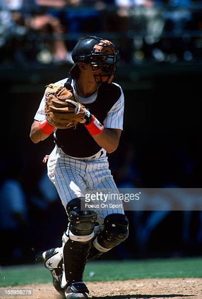 Benito Santiago of the San Diego Padres in action during an Major League Baseball game circa 1989 at Jack Murphy Stadium in San Diego California...