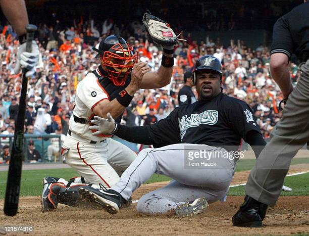 Benito Santiago of the San Francisco Giants tags out Lenny Harris of the Florida Marlins during the NLDS Game 2 at Pac Bell Park in San Francisco Ca