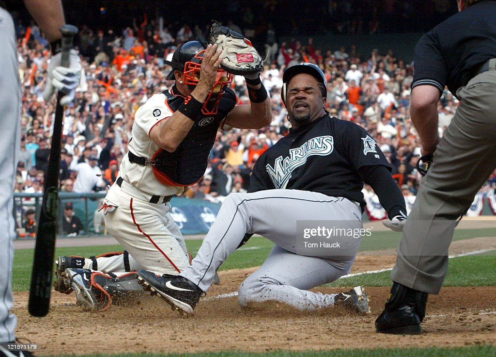 Benito Santiago #33of the San Francisco Giants tags out Lenny Harris #10 of the Florida Marlins during the NLDS Game 2 at Pac Bell Park in San Francisco, Ca.