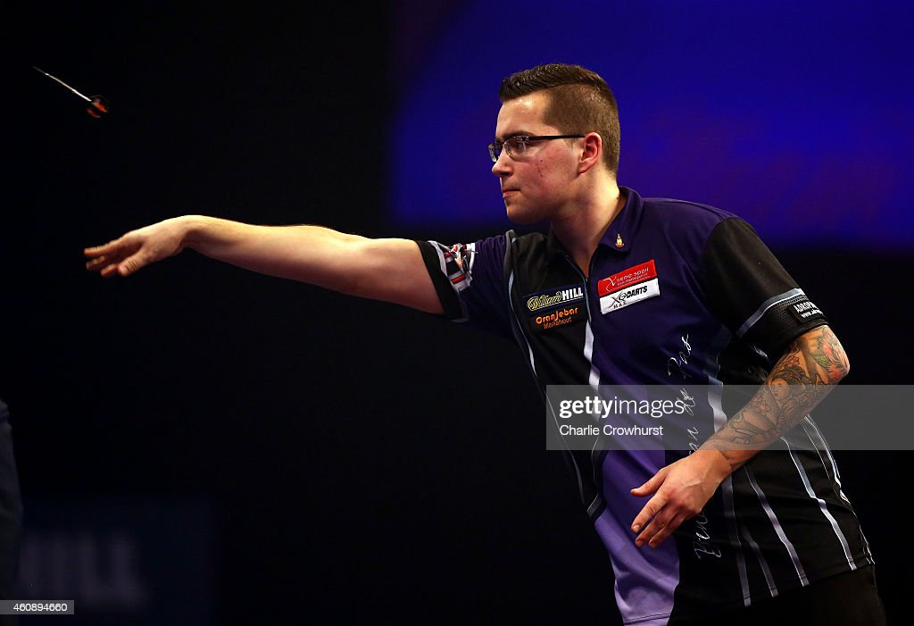 Benito van de Pas of Holland in action during his third round match against Robert Thornton of Scotland during the William Hill PDC World Darts Championships on Day Nine at Alexandra Palace on December 29, 2014 in London, England.