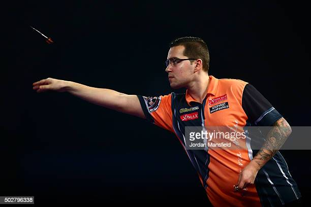 Benito van de Pas of Holland in action in his third round match against Michael Smith of England on Day Eleven of the 2016 William Hill PDC World...