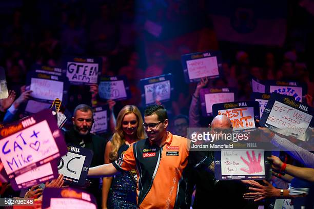 Benito van de Pas of Holland walks on ahead of his third round match against Michael Smith of England on Day Eleven of the 2016 William Hill PDC...