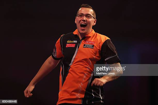 Benito van de Pas of the Netherlands celebrates his win against Terry Jenkins of Great Britain during day nine of the 2017 William Hill PDC World...