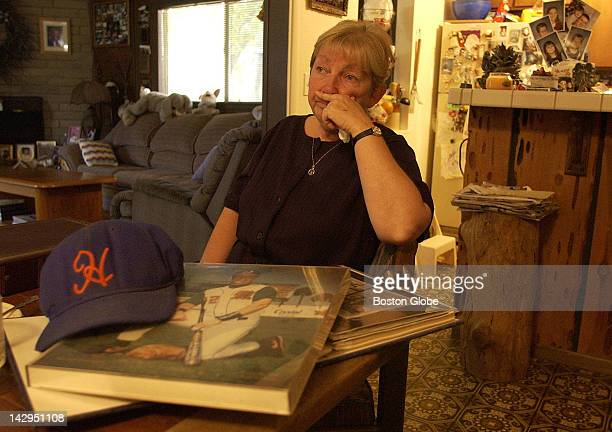 Benitta Erwin mourns her son Mat Erwin who was killed by his estranged wife in 1997 His scrapbook and Hyannis Mets cap are mementos of his baseball...
