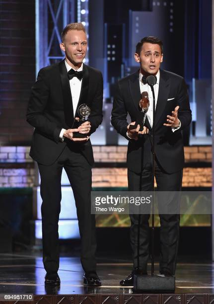 """Benj Pasek and Justin Paul accept the award for Best Original Score Written for the Theatre for """"Dear Evan Hansen"""" onstage during the 2017 Tony..."""
