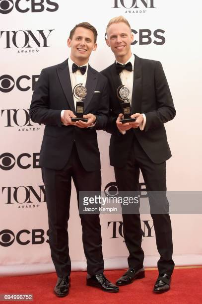 """Benj Pasek and Justin Paul, winners of the award for Best Score for """"Dear Evan Hansen,"""" pose in the press room during the 2017 Tony Awards at 3 West..."""