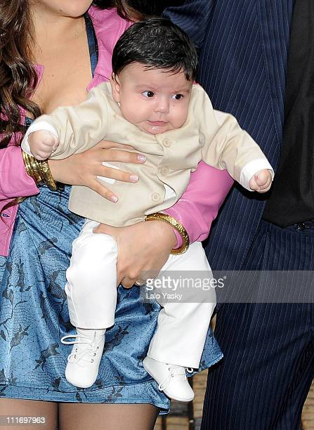 Benjamin Aguero Maradona arrives on his mothers arms at the Nuestra Senora de Balvanera Church for his christening on June 20 2009 in Buenos Aires...