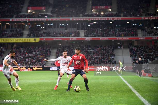Benjamin ANDRE - 07 Haris BELKEBLA during the Ligue 1 Uber Eats match between Lille and Brest at Stade Pierre Mauroy on October 23, 2021 in Lille,...