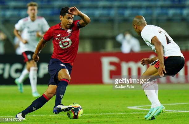 Benjamin Andre of LOSC Lille with Joao Mario of SL Benfica in action during the Pre-Season Friendly match between SL Benfica and Lille at Estadio...