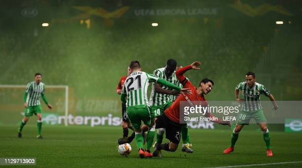 Benjamin Andre of Rennes is challenged by Giovani Lo Celso of Betis during the UEFA Europa League Round of 32 First Leg match between Stade Rennais...