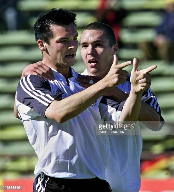 Benjamin Auer and Christian Tiffert of Germany celebrate their team's first goal against France during their World Cup Sub20 Championship Soccer...