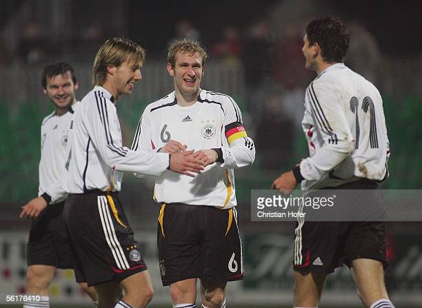 Benjamin Auer of Germany watches his team mates Fabian Gerber Alexander Madlung and Mario Gomes celebrating the fourth goal during the international...