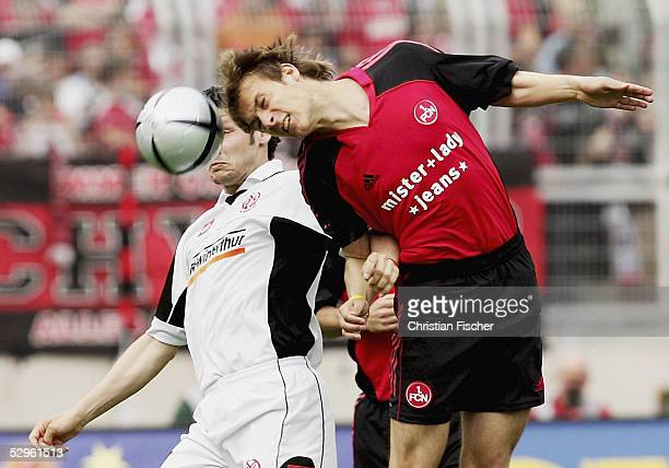 Benjamin Auer of Mainz and Maik Wagefeld of Nuremberg fights for a header during the Bundesliga match between 1 FC Nuremberg and 1 FSV Mainz 05 at...