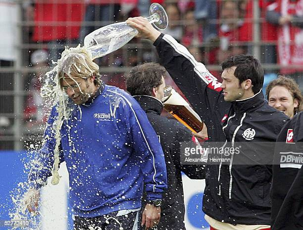 Benjamin Auer of Mainz pours beer on headcoach Juergen Klopp after the Bundesliga match between FSV Mainz 05 and FC Bayern Munich at the Bruchweg...