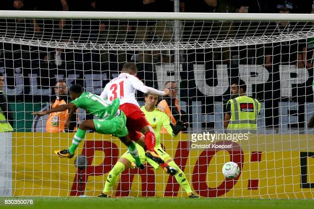 Benjamin Baier of Essen scores the first goal during the DFB Cup first round match between RotWeiss Essen and Borussia Moenchengladbach at Stadion...