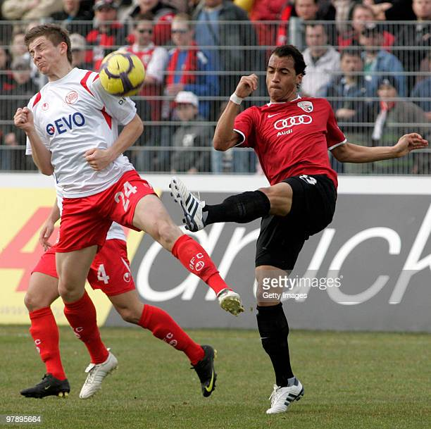 Benjamin Baier of Kickers Offenbach and Malte Metzelder of FC Ingolstadt battle for the ball during the 3Liga match between FC Ingolstadt and Kickers...