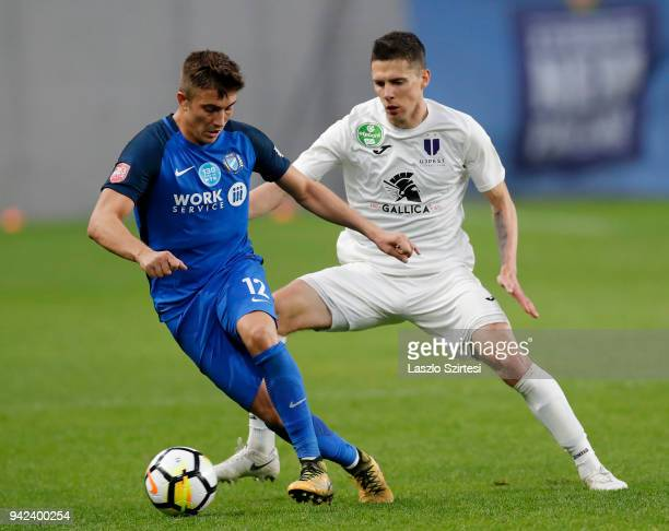 Benjamin Balazs of Ujpest FC challenges David Jakab of MTK Budapest during the Hungarian Cup Quarter Final 2nd Leg match between MTK Budapest and...