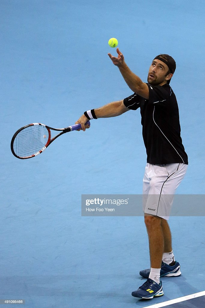 Benjamin Becker of Germany competes against David Ferrer os Spain during the 2015 ATP Malaysian Open at Bukit Jalil National Stadium on October 3, 2015 in Kuala Lumpur, Malaysia.