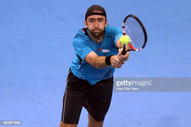 Benjamin Becker of Germany competes against Grigor Dimitrov of Bulgaria during the 2015 ATP Malaysian Open at Bukit Jalil National Stadium on October...