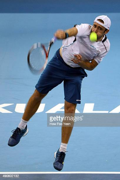 Benjamin Becker of Germany competes against Jeremy Chardy of France during the 2015 ATP Malaysian Open at Bukit Jalil National Stadium on September...
