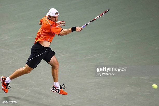 Benjamin Becker of Germany in action during the men's singles second round match against Tatsuma Ito of Japan on day three of Rakuten Open 2014 at...