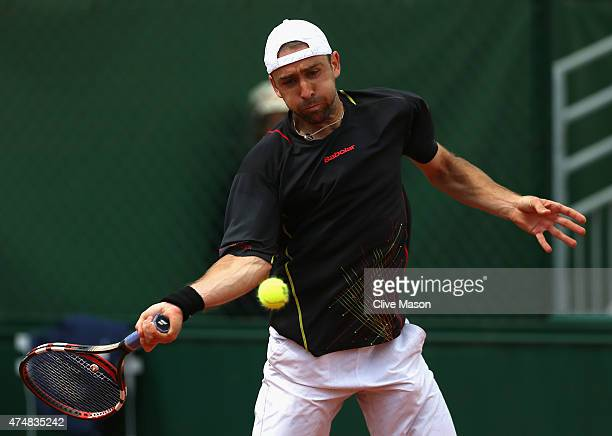 Benjamin Becker of Germany plays a forehand in his Men's Singles match against Fernando Verdasco of Spain during day four of the 2015 French Open at...