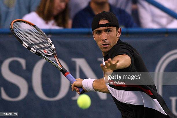 Benjamin Becker of Germany returns a shot against Andy Roddick during Day 3 of the Legg Mason Tennis Classic at the William H.G. FitzGerald Tennis...