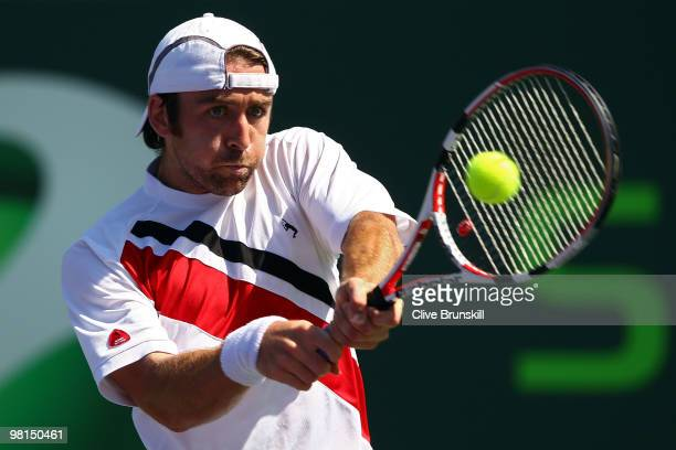 Benjamin Becker of Germany returns a shot against Andy Roddick of the United States during day eight of the 2010 Sony Ericsson Open at Crandon Park...