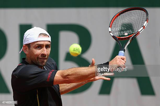 Benjamin Becker of Germany returns a shot in his Men's Singles match against Fernando Verdasco of Spain during day four of the 2015 French Open at...