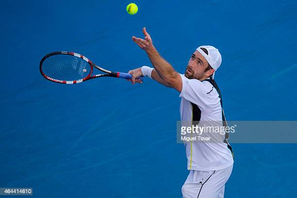 Benjamin Becker of Germany serves during a men's singles match against Bernard Tomic of Australia as part of Telcel Mexican Open 2015 at Mextenis...