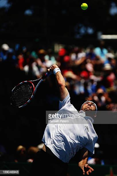 Benjamin Becker of Germany serves in his first round match against Lukas Rosol of Czechoslovakia during day one of the Heineken Open at ASB Tennis...
