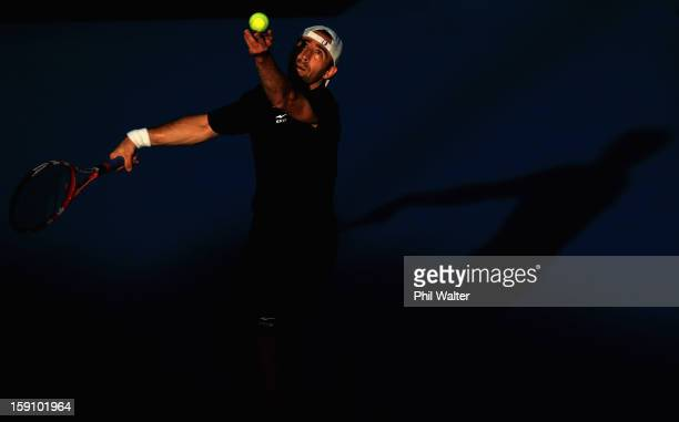 Benjamin Becker of Germany serves in his first round match against Gael Monfils of France during day two of the Heineken Open at the ASB Tennis...