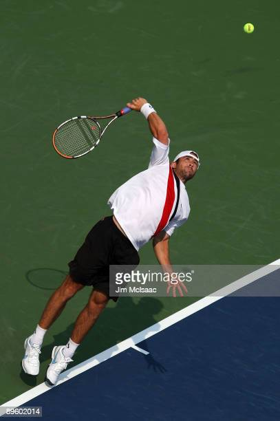 Benjamin Becker of Germany serves to Robby Ginepri during Day 2 of the Legg Mason Tennis Classic at the William H.G. FitzGerald Tennis Center August...